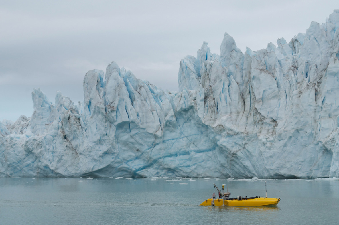 "Photo of the ""Jetyak"" in the ocean near Greenalnd's glaciers"